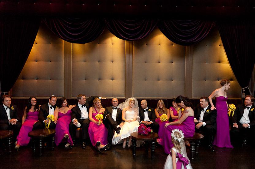The many bridesmaids wore vibrant Wedding Library gowns in different styles.