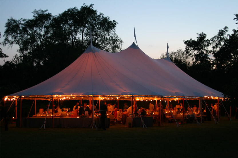 The flag-topped sailcloth tent held a buffet of whole roast suckling pig with all the traditional Tex-Mex accoutrement.  (And an English dessert.)