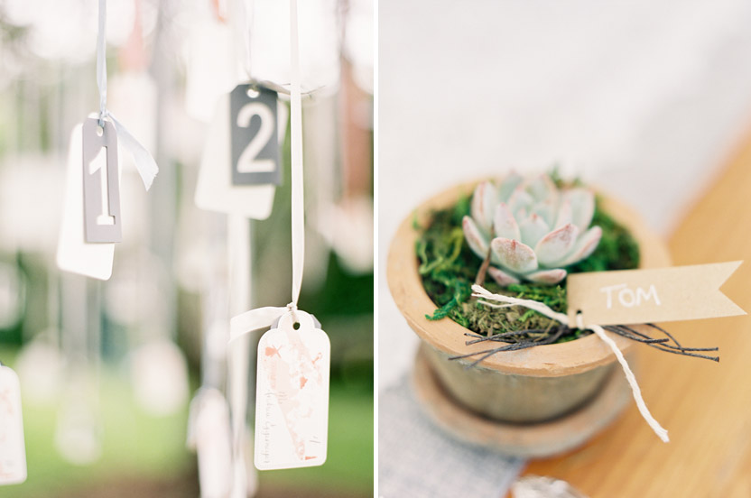 Hidden orchard trees held escort cards on seam binding, lace ribbons and twine in wedding colors – we tied them to zinc table numbers that we found to weigh them down from the passing breeze.