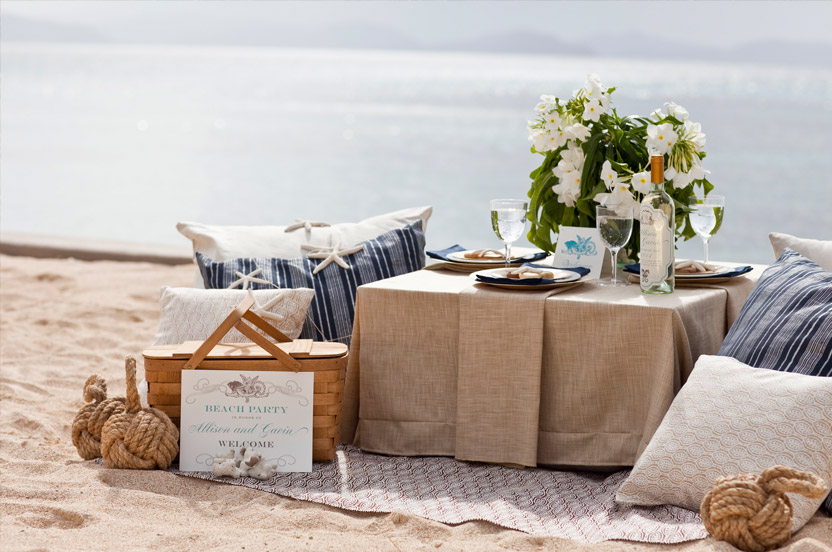I styled a welcome beach party with low tables, large cushions, complementary fabrics and natural materials.
