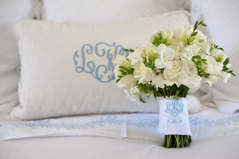 Every detail was thought through. The bed pillow has the bride's mother's monogram and the pretty bridal handkerchief has the bride's new monogram and wedding date.