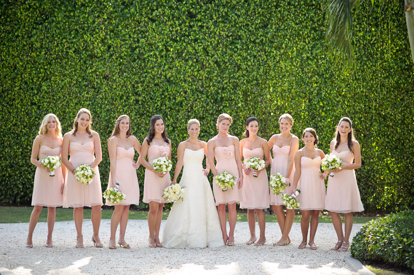 The garden made for some of the prettiest portraits. Bridesmaids wore dresses from the Wedding Library in two pretty styles.