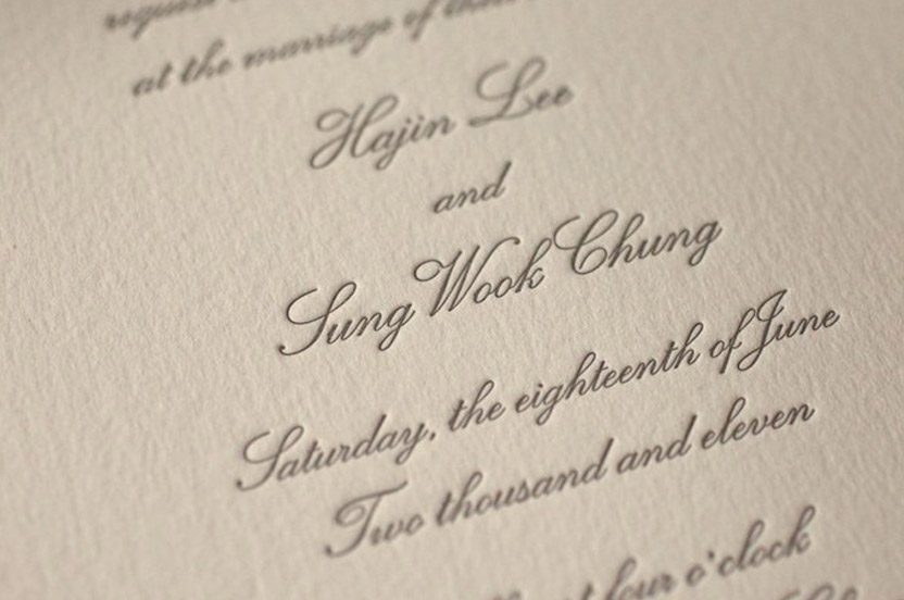 We chose a conservative letterpress invitation in a soft gray.