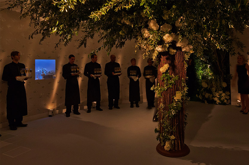 On one side of the 24-foot rotunda guests are greeted by waiters bearing champagne, on the other side, hand-made silvered leaf push-pins secure escort cards.