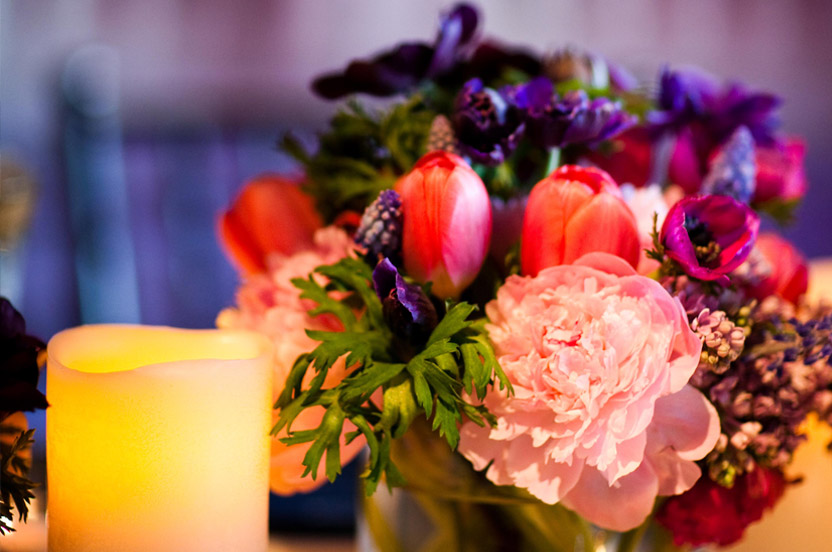 The bright colors remained for cocktails then became more subdued for dinner, where petal pink and gold were folded into the color scheme.