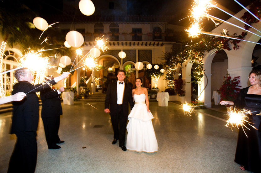 As the bride and groom get ready to leave our team hands out extra long sparklers to send them on their way.