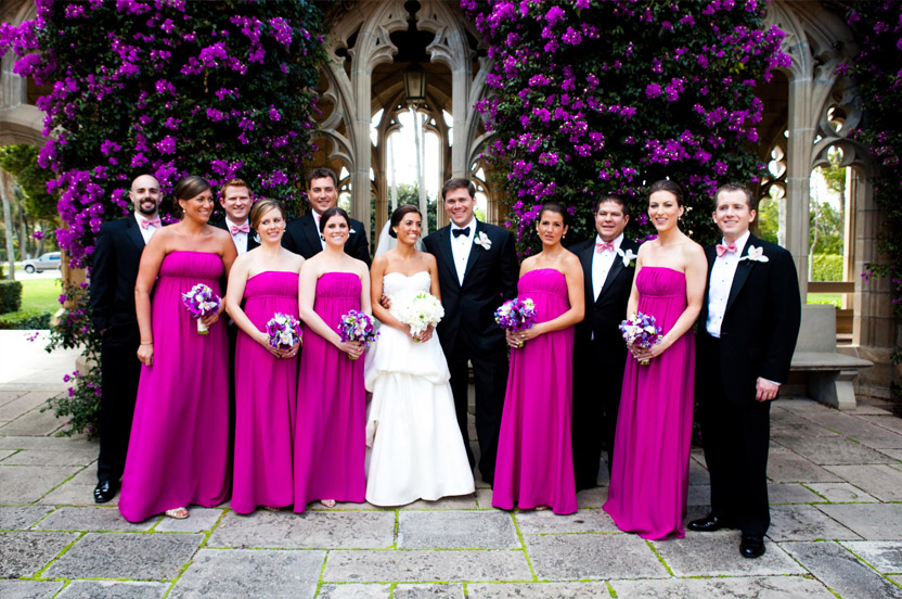 The bridal party wore Wedding Library gowns, and the bright pink worked well with the bouquets, the surrounding flowers and the hot climate.