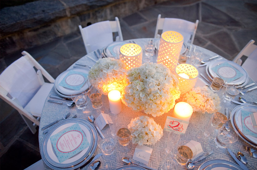 Smaller, 'satellite' flower arrangements and a mix of candlelight add interest and texture from every vantage point.