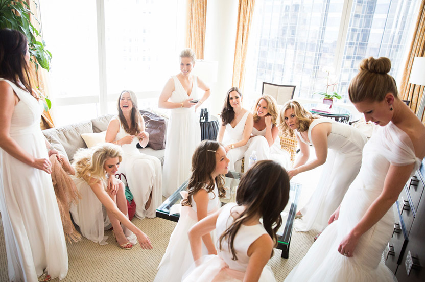 The bride and her bridesmaids all looked stunning in white Monique Lhuillier, from the Wedding Library. A corner hotel suite had enough room for all the bridesmaids (and flower girls) to get ready.