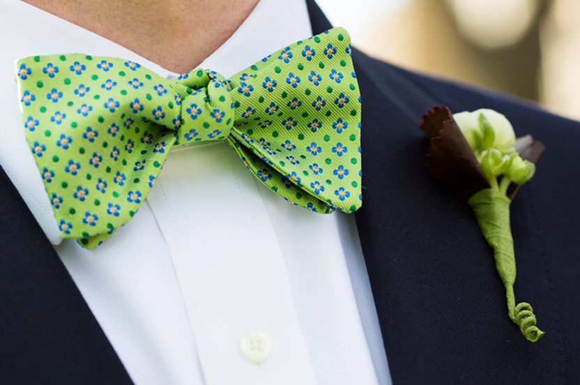 The groom and groomsmen wore matching bowties and ties in springtime green. We made sure the boutonnieres would match perfectly.