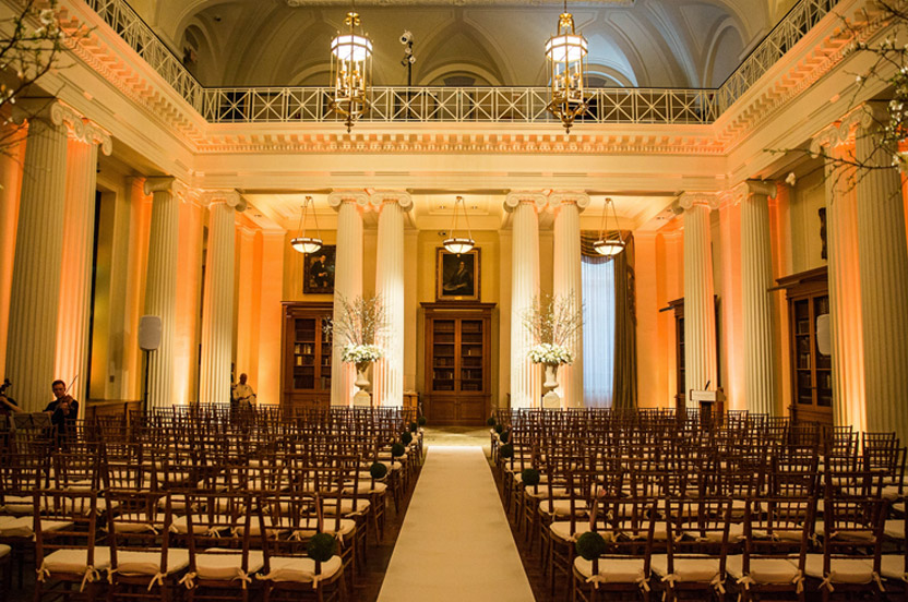 The museum's library was cleared of all furniture for the ceremony and the dancing afterwards. All that was needed to highlight the room was the stunning urns, a clean white runner and warm lighting.