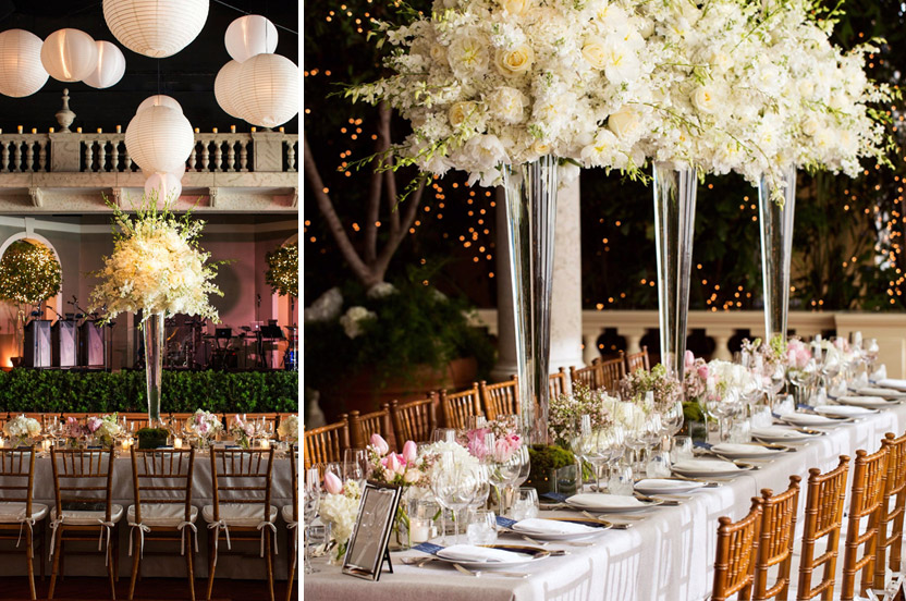 Tall arrangements and dozens of trees with twinkling lights help to fill the voluminous space.
