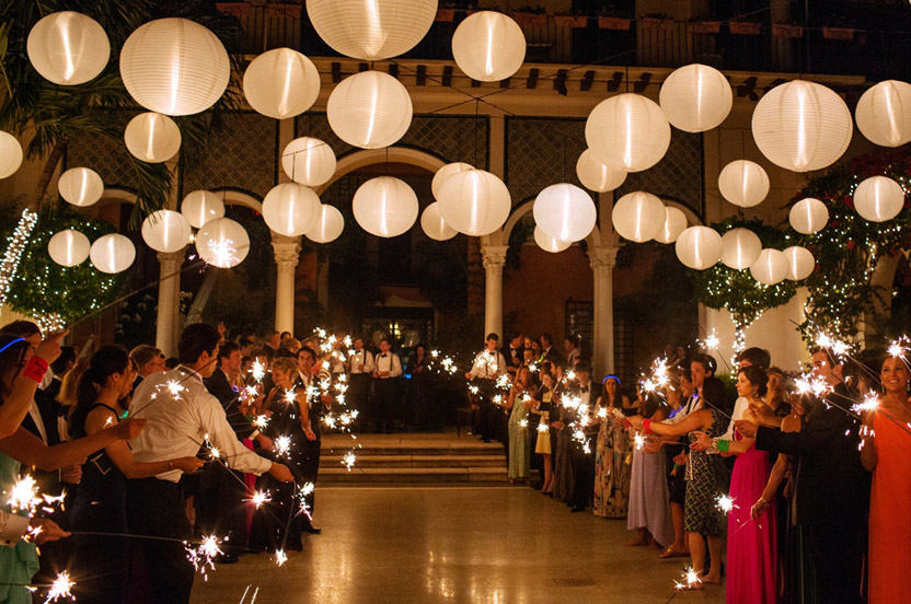 An aisle of departing guests held extra-long sparklers for a brilliant send off for the married couple.