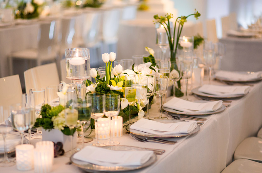 The constructed centerpieces contained calla lilies, tulips, orchids, hydrangea blossoms, ferns and crisp greens.