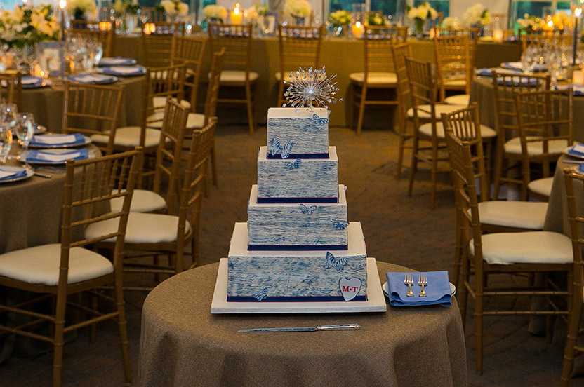 Master baker Ron Ben-Israel, a longtime friend of the groom, created this stunner of a cake. The faux bois of the invite is incorporated and butterflies from the paper suite make an appearance. Finally, the cake is topped with the fireworks of the fourth of July.