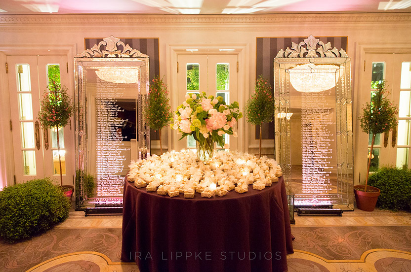 "We utilized the rooftop foyer to display two eight-foot Venetian mirrors with the guests' seating inscribed. We wrapped beautiful little custom-designed boxes of chocolates and topped them with traditional sugared almonds. Symbolic for both the bride and groom's cultures they're called ""koufetta"" meaning ""confetti"" by the Greeks and ""dragee"" by the French Moroccans."