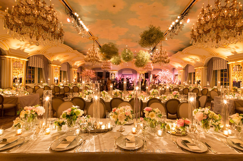 """The room set up was designed for elegance. We also wanted to ensure that there was no """"bad"""" seat, that everyone had easy access to the dance floor and had a great view. Careful planning of this large party was in order – especially with the rectangular table format, and the oversized rental chairs."""