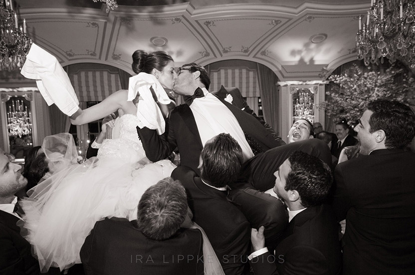 Managing a kiss during the horah is no small feat, but this couple was ready for everything!