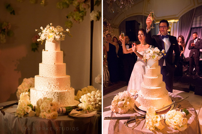 The Ron Ben-Israel cake is decorated with sugar lace lifted from the bride's dress and the dots from the invitation design. It looks picture perfect and tastes even better. The bride and groom successfully cut the cake with the St. Regis' signature saber.
