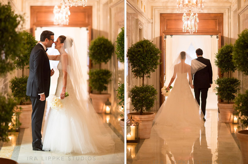 "After the ""first look"" in a stunningly decorated marble hall of the hotel, the bride and groom take a peek at the ceremony space."