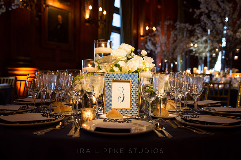 High and low arrangements with a variety of Wedding Library Collection table number frames create interest.