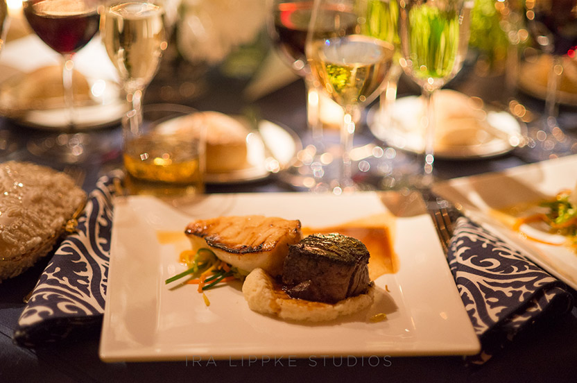 "The couple chose a fish and beef combination, ensuring that no one would go hungry. We added custom, patterned napkins to the table décor to provide ""pop""."