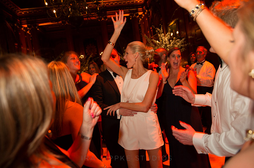 The bride changes into a white jumpsuit to keep partying late into the night.