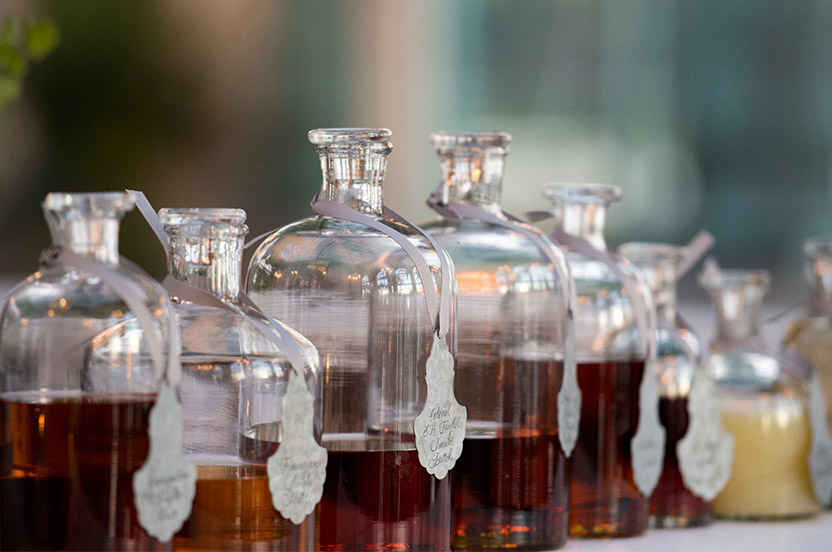 Our bourbon bar featured hard-to-find vintages and the groom's favorites. We provided the old-fashioned apothecary jars and hand calligraphy on zinc labels to complete the look.