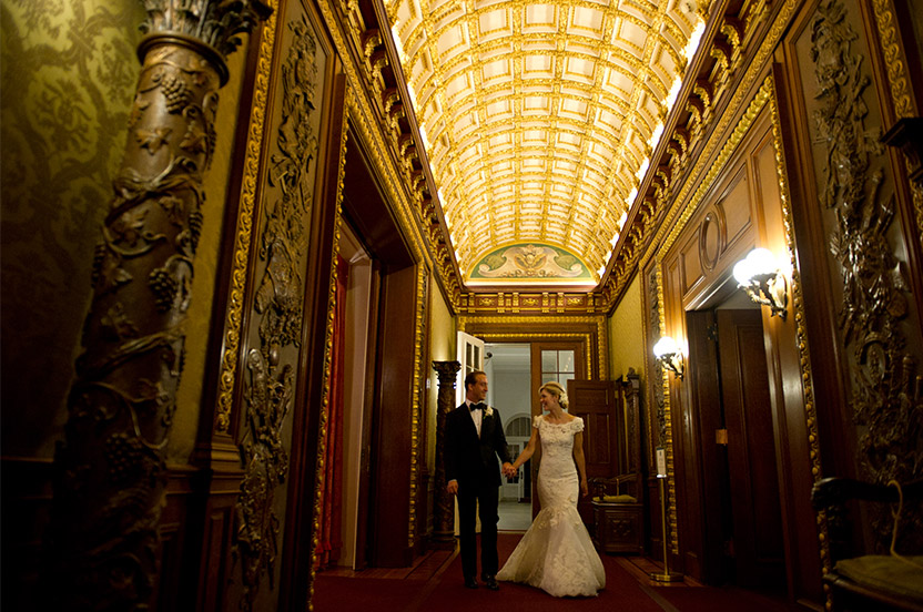 The bride and groom make their entry through the Flagler mansion. Turn-of-the-century opulence is evident everywhere. It was a joy to design this wedding using the vernacular of this amazing architectural and design treasure.