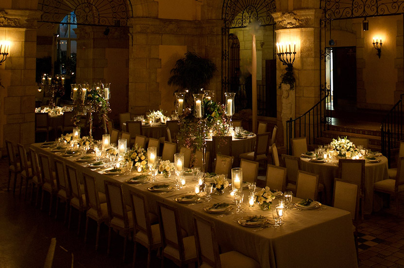 The candlelit ballroom was spectacular. I designed the room with rectangular and round tables; custom chairs I sourced from overseas reinforced the subtly opulent look. High and low arrangements were placed strategically for maximum effect.
