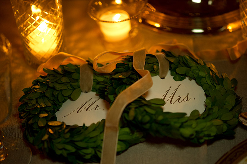 Sweet wreaths mark the spots for the bride and groom.