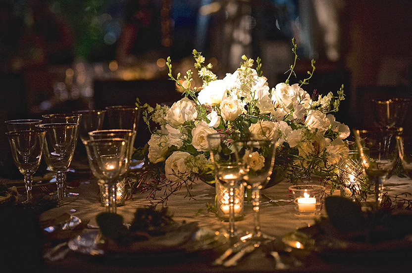 The low table arrangements are loose and natural.  Linens were ordered from California, chargers and plates from New York and glassware from Atlanta.  The chairs are from Charleston and the menus from Virginia.  Guests were from all over the world.