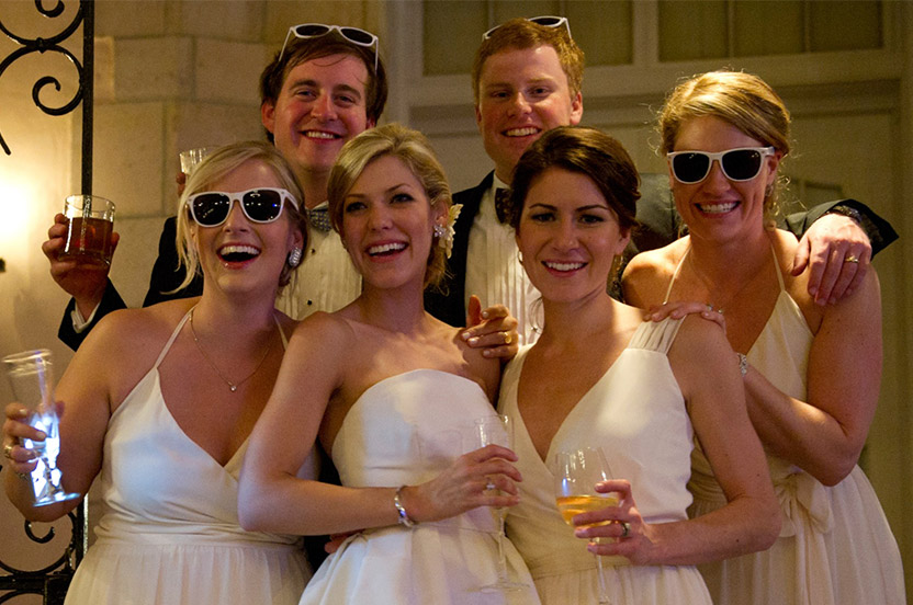 The bride changed into a short dress late in the evening – the bridal party loosened up with fun customized sunglasses – they were handed out to everyone in an instant!