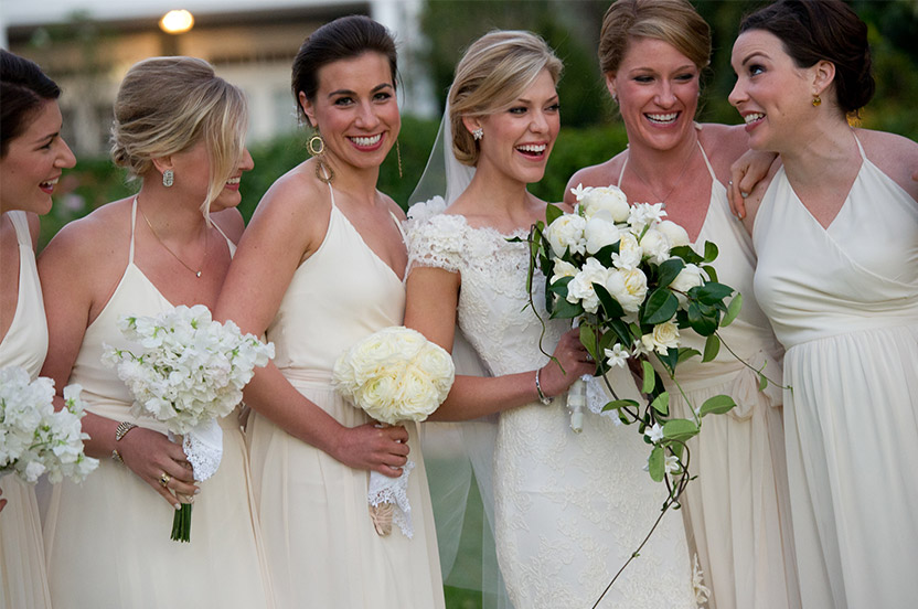 Bridesmaids wore Wedding Library gowns and each had a different bouquet, wrapped in the wedding's signature vanilla velvet ribbon. We sourced the Austrian linen handkerchiefs, which we then embroidered with each bridesmaid's initials and the wedding date. The bridal party carried them down the aisle to capture their tears (of joy).