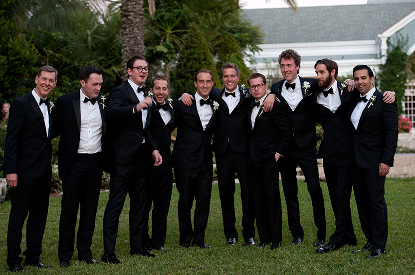 Groomsmen looked dapper in bespoke tuxedos. The classic stephanotis boutonnieres are timeless, and mirror the blossoms in the bride's bouquet.